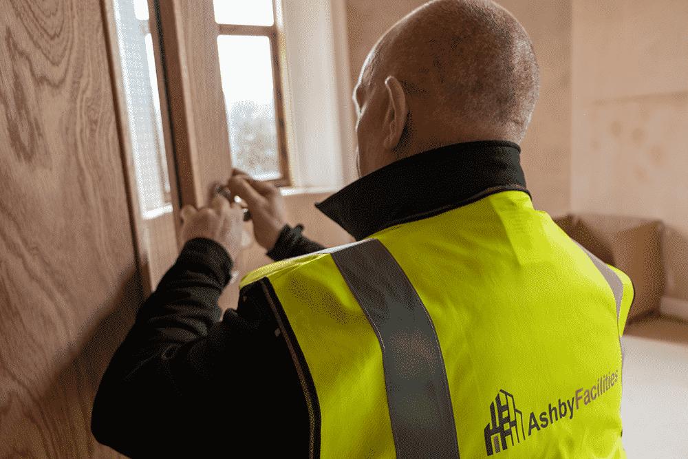 commercial maintenance contractors working on interior door