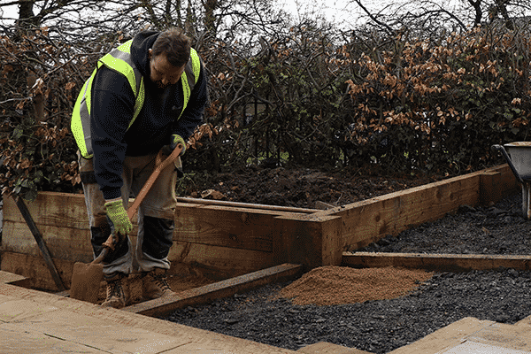 ashby facilities employee working on garden site for local authority